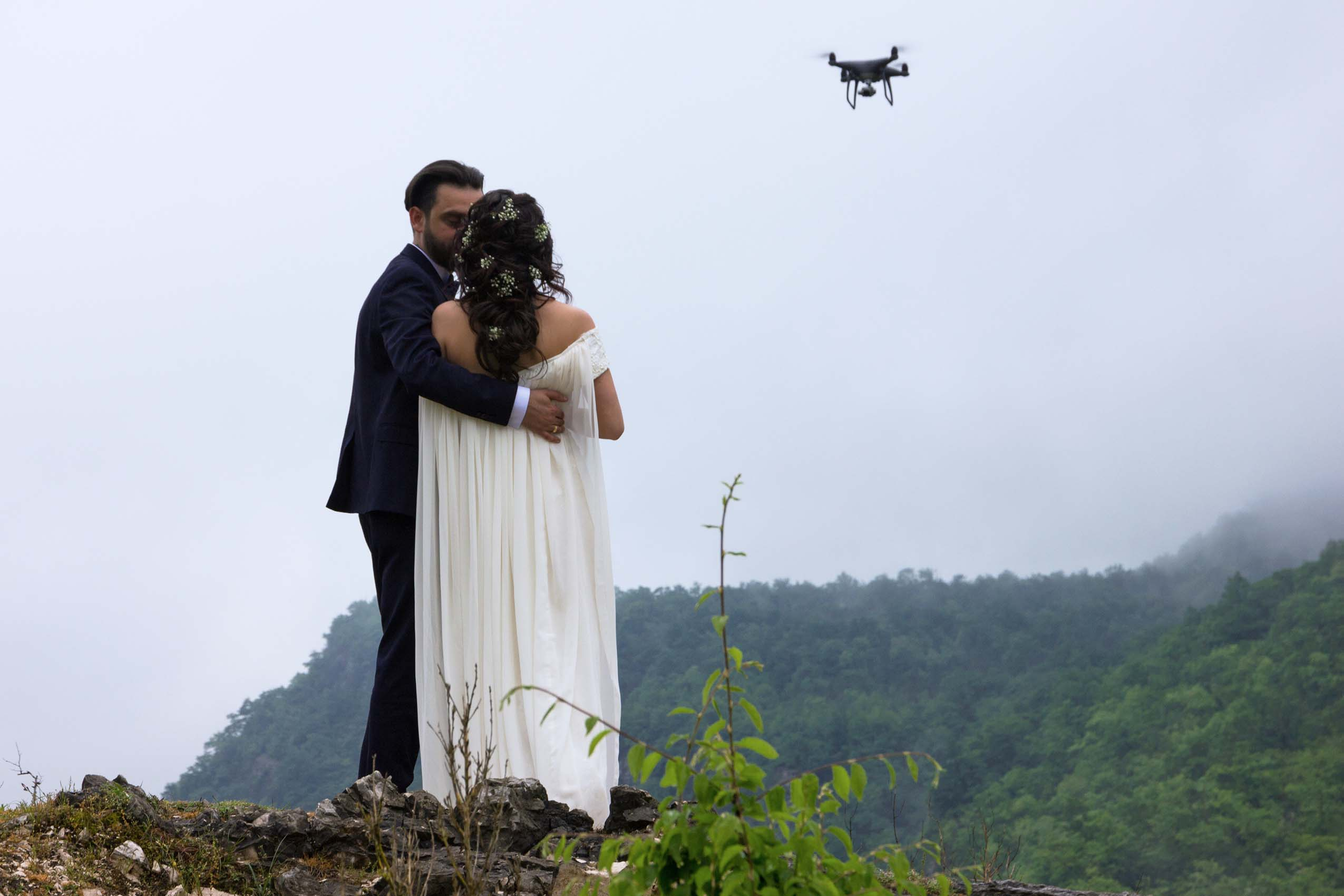 Wedding kissing couple with drone in Georgia, Caucasus. Groom and bride.